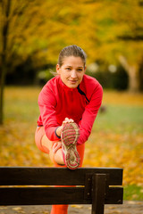 Woman stretching before running