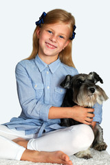 Happy person and her beautiful dog over white background