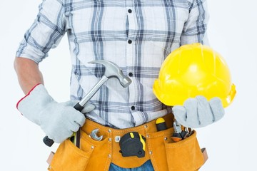 Handyman holding hammer and hard hat