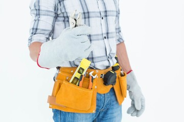Technician with tool belt around waist holding pliers