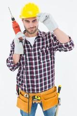 Confident handyman holding drill machine