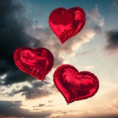Composite image of love heart balloons