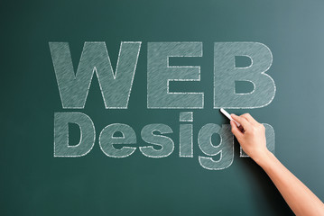 web design written on blackboard