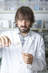 male pharmacist and test tubes.