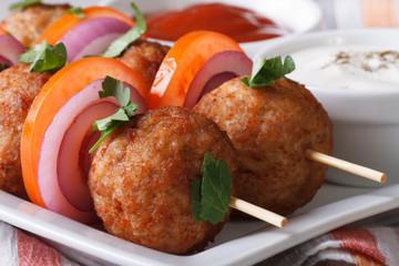 meatballs on skewers with fresh vegetables macro. horizontal