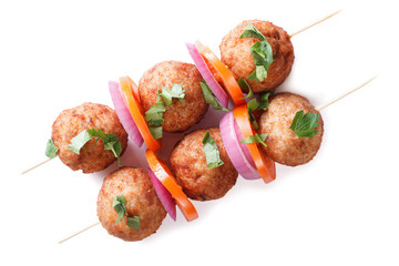 Roasted meatballs on skewers isolated on white top view