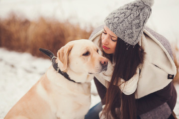 Portrait young woman and her labrador