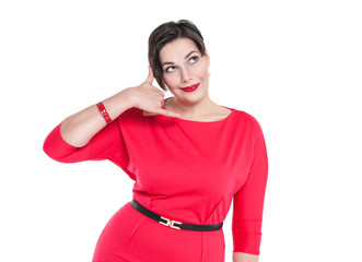 Beautiful plus size woman in red dress with call gesture isolate