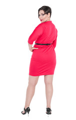 Beautiful plus size woman in red dress posing