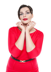 Sexy beautiful plus size woman in red dress posing isolated