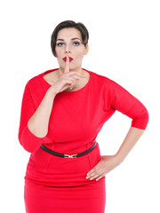 Beautiful plus size woman in red dress with finger on lips isola