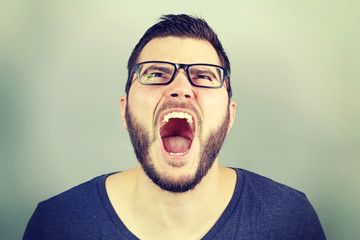 portrait of a businessman screaming
