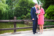 photo of the bride and groom on a bridge near a park