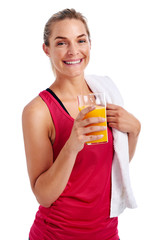 Workout woman drinking juice