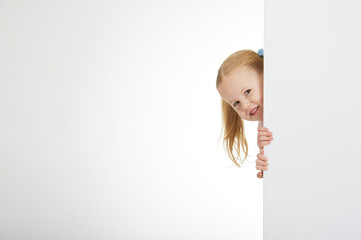 Beautiful little girl with white copy space on a white backgroun