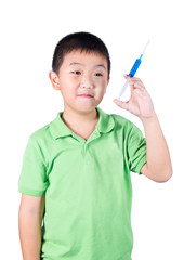 A boy wearing green t-shirt, holding syringe in his hand