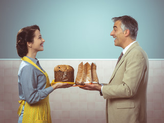 Smiling vintage couple with cakes