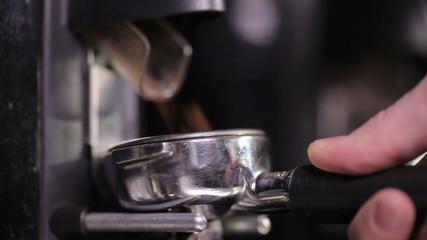 Making Ground Coffee with Coffee Grinder. Fresh Ground Coffee.