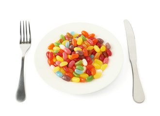 Multiple colorful candies in a plate isolated