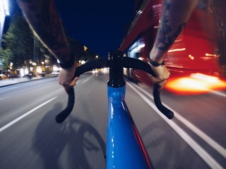 Fast riding in traffic in night streets of city