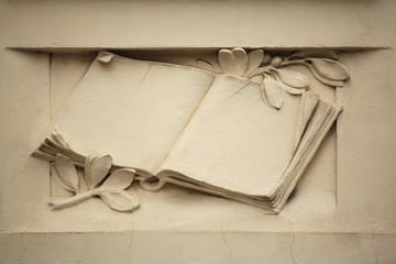 Medieval book. Stucco decoration on the Art Nouveau building