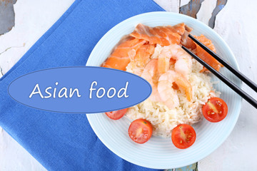 Boiled rice with shrimps and salmon