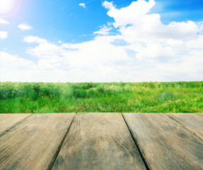 Wooden board on landscape background
