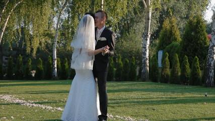 bride and groom make step on the wedding towel.