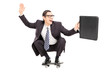 Leinwandbild Motiv Excited businessman riding a skateboard to work
