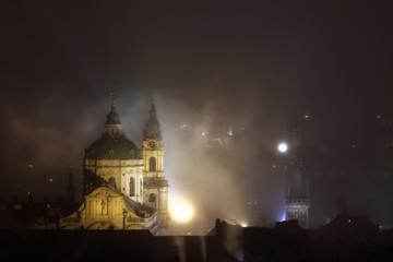 Night fog over Saint Nicholas Church in Prague, Czech Republic.