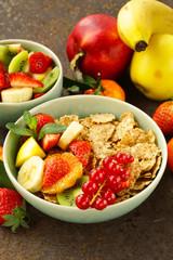 homemade granola muesli with fruit salad for breakfast