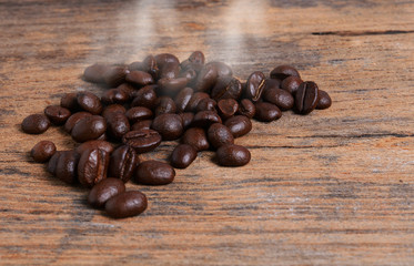 Coffee beans on wood texture