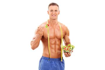 Handsome man eating a salad