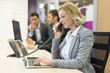Businesswoman talking on the phone in modern office - 76359618