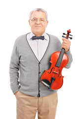 Vertical shot of a mature violin player posing