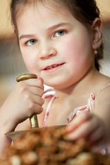 Cute little girl with walnut