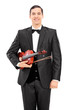 Young violinist holding a violin and posing