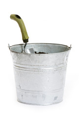 Garden: Metal Pail Full of Dirt and Shovel