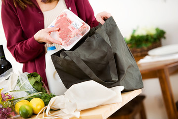 Reusable: Woman Removes Steak from Grocery Bag
