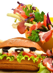 Tasty fresh sandwich and shawarma with green lettuce, tomatoes,