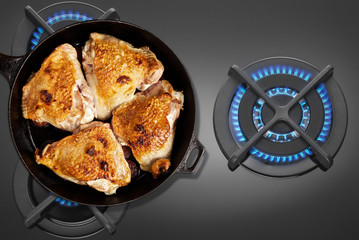 Pan fried chicken on the gas stove