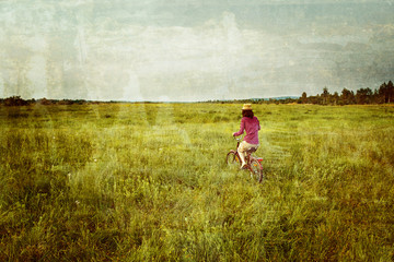 Hipster girl is cycling in summer, vintage image
