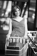 Beautifull woman with shopping cart