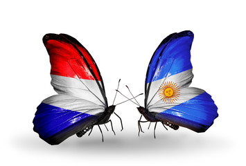 Two butterflies with flags Holland and Argentina