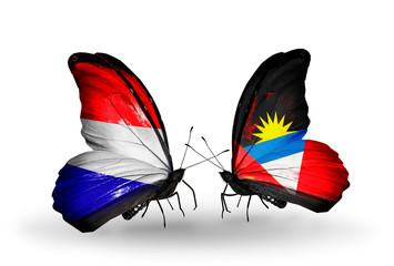 Two butterflies with flags Holland and Antigua and Barbuda
