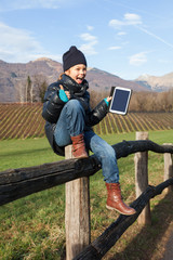 child play with her tablet during outdoor excursion