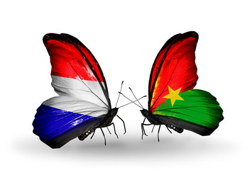 Two butterflies with flags Holland and Burkina Faso