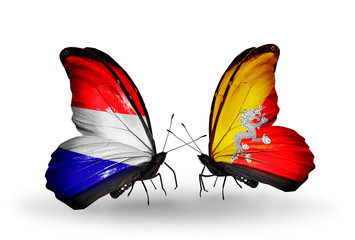 Two butterflies with flags Holland and Bhutan