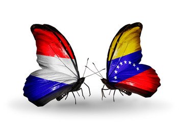 Two butterflies with flags Holland and Venezuela