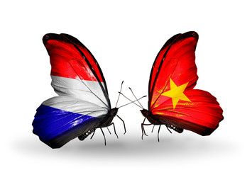 Two butterflies with flags Holland and Vietnam